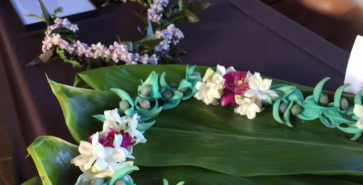 green and white floral garland on table