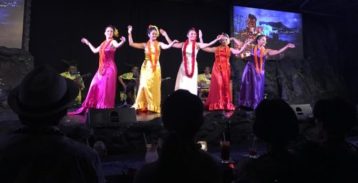 five women dancing on stage