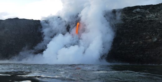 lava pouring on body of water