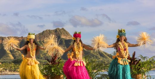 three woman dancing during daytime