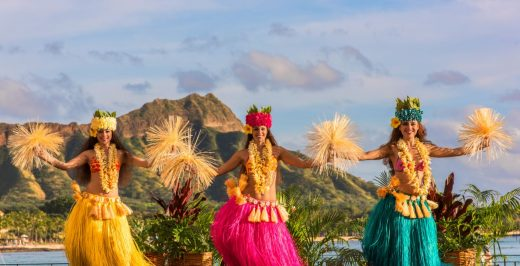 three women in Hawaiian dresses