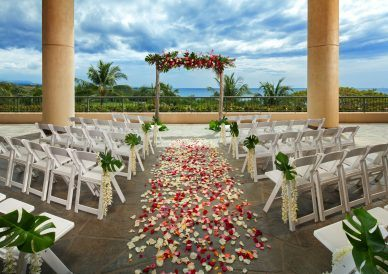 brown concrete aisle with red and white rose petals during daytime