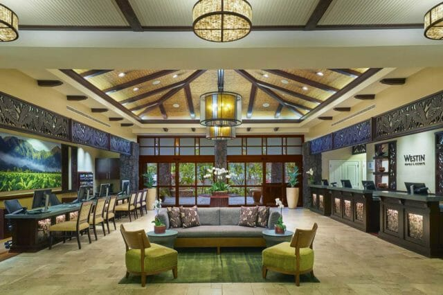 large hotel lobby with concierge desk and chairs
