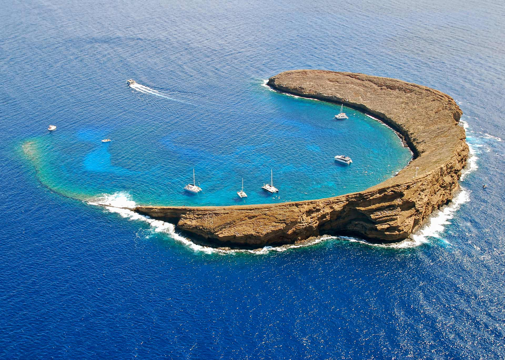 bird's eye photography of c-formed island