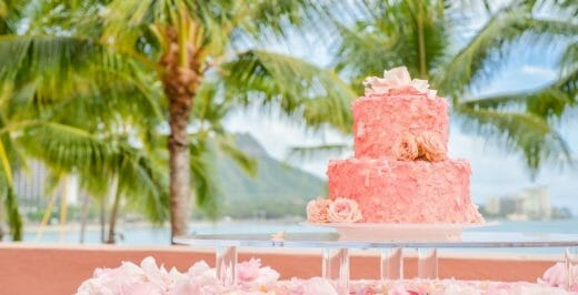 pink 2-layer cake on glass tray during daytime
