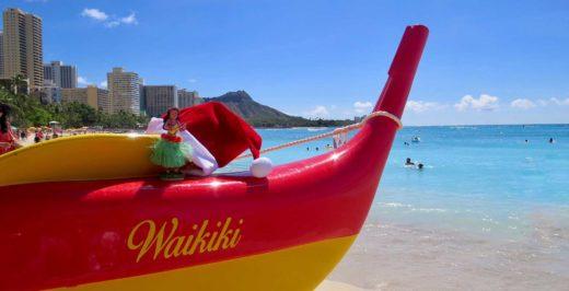 red and yellow Waikiki boat facing beach at daytime
