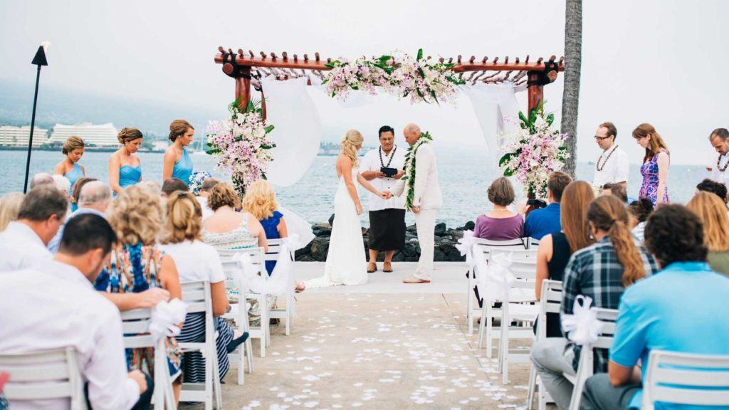 outdoor wedding officiated by minister overlooking the sea