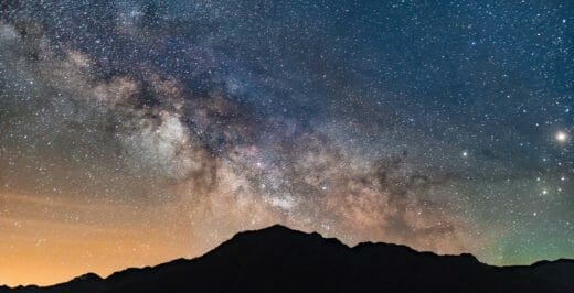 mountain range under milky way