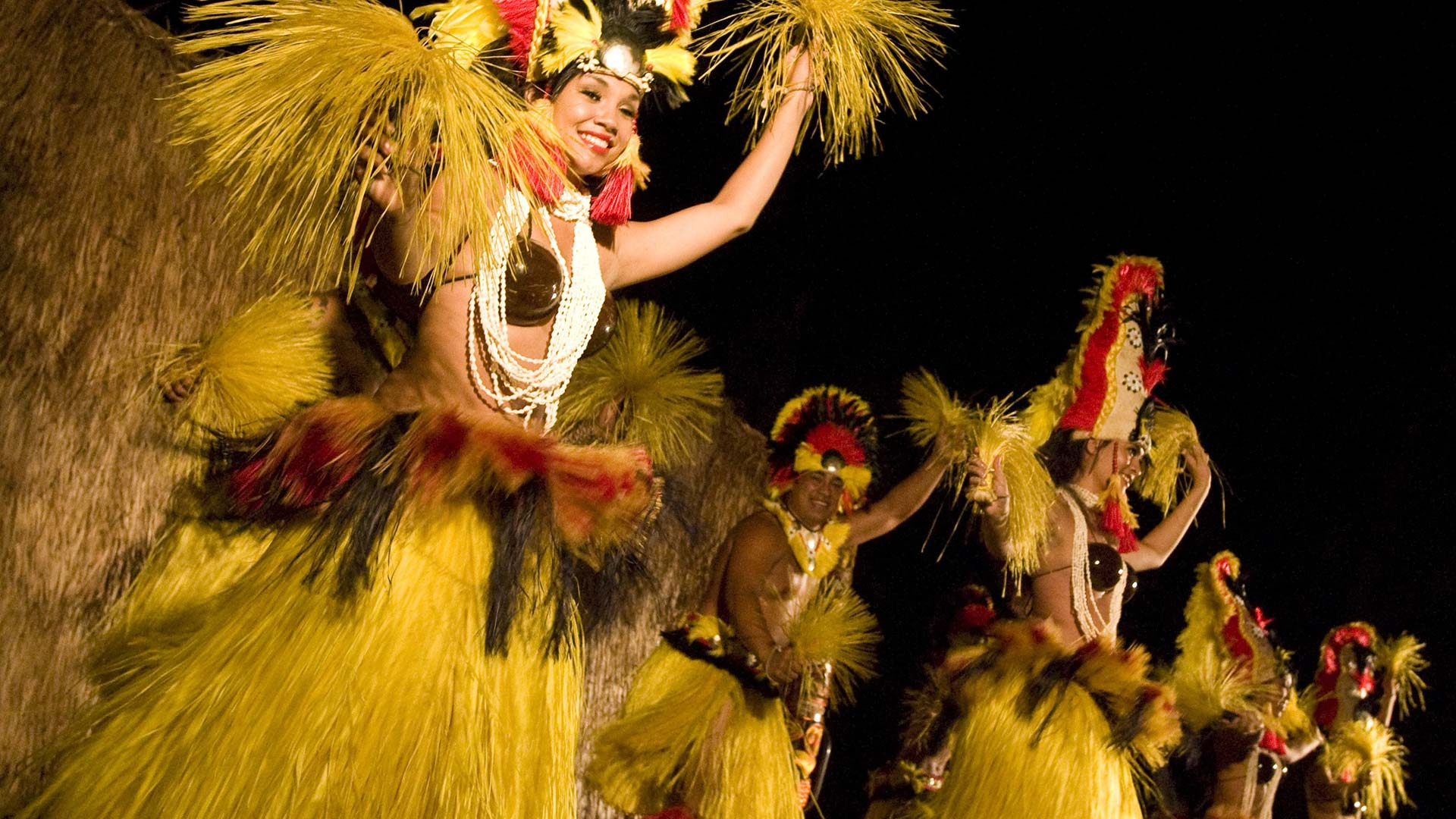 group of people dancing Hawaiian during nighttime