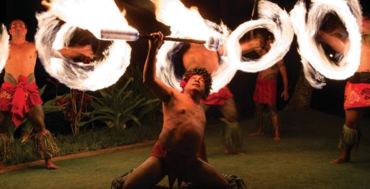 man doing fire dance at night