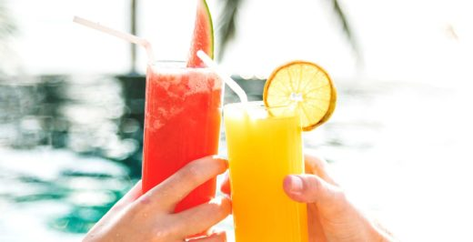 selective focus photography of \two watermelon and orange juice in drinking glasses