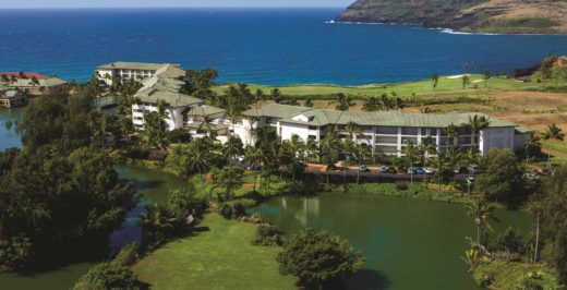 aerial view of kauai beachfront resort with lakes in the foreground