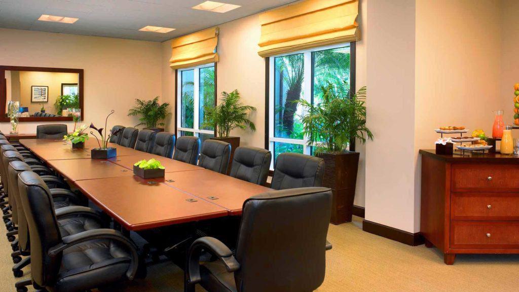 brown wooden conference table