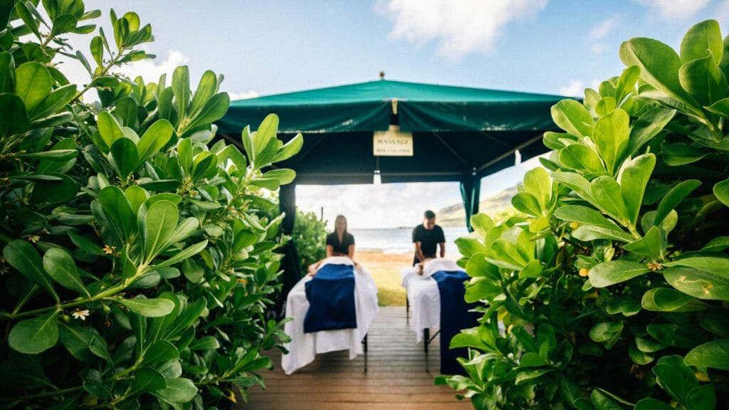 view of cabana through bushes with couple receiving massages